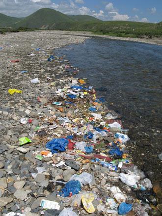 Trash along River, China