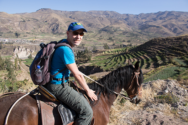 Thomas riding in above Colca Lodge