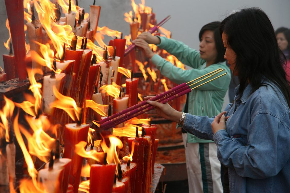 Visitors making offers at the peak of Emei Shan