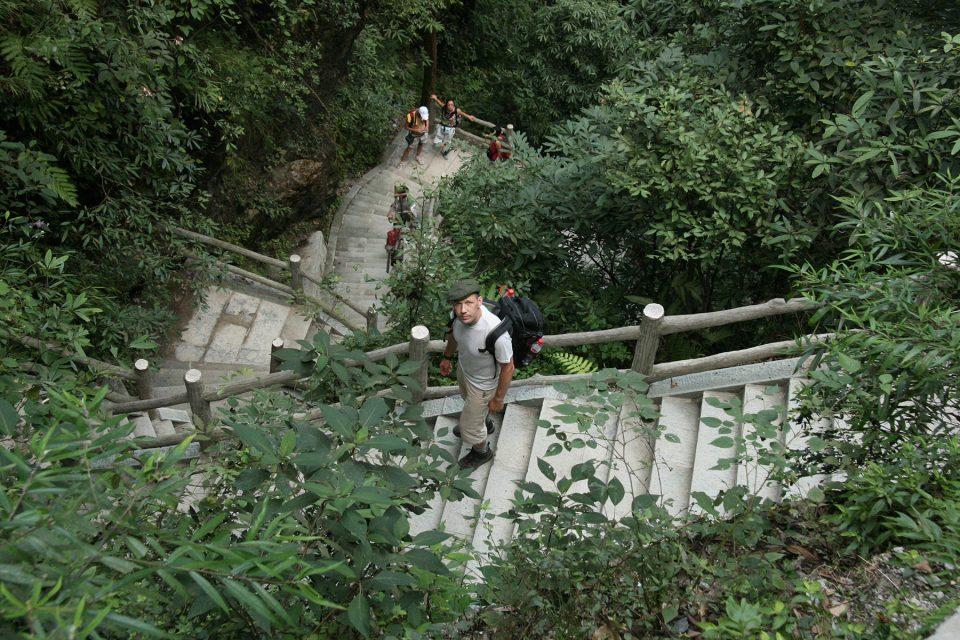 Hiking down steep steps of Emei Shan