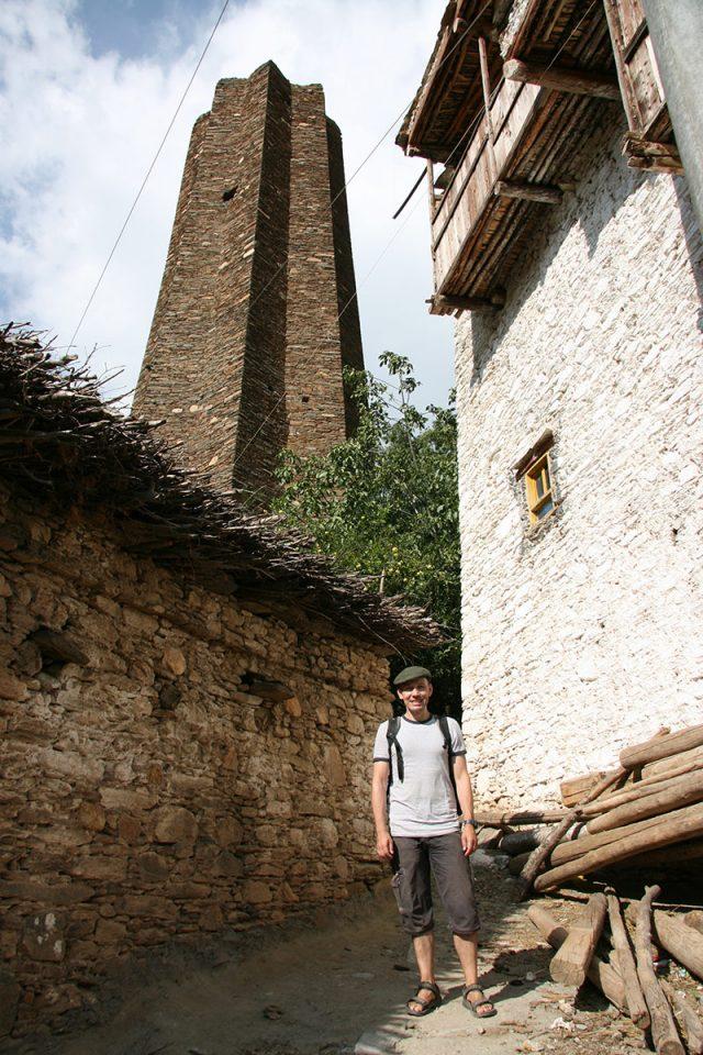 Thomas at the base of a star-shaped Qiang tower