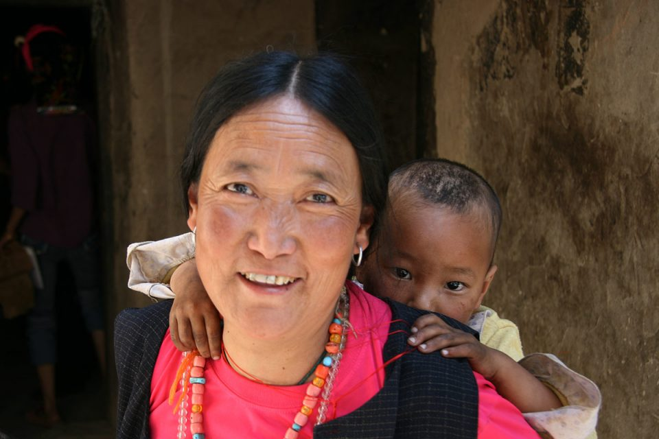 Qiang woman with her baby