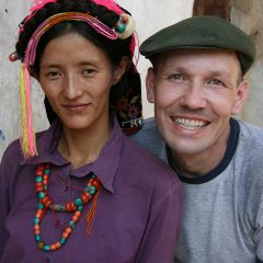 Thomas posing with a Qiang woman
