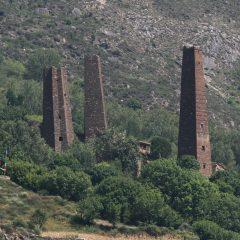 Qiang towers on hillside near Danba