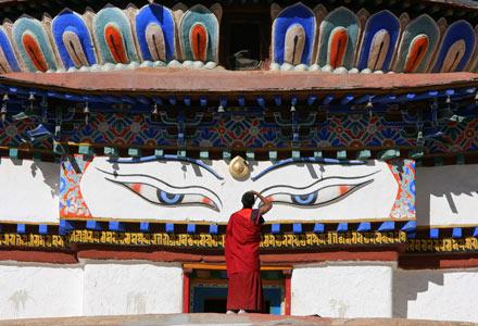 Monk Standing on Kumbum in Gyantse Monastery, Tibet