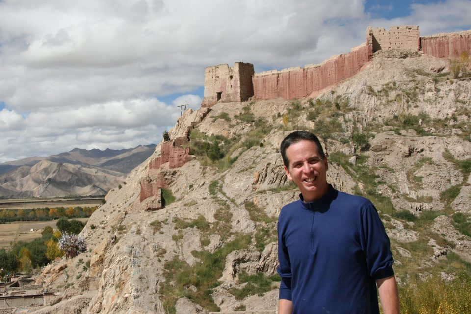 Tony backed by the walls of Palcho Monastery