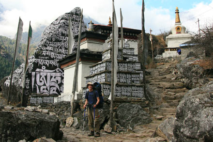 Tony in Front of a Carved Stupa and Boulder