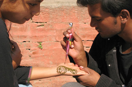 Young Nepali Applying Henna Paste