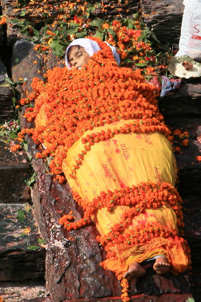 Woman Covered in Flowers at the Bagmati River