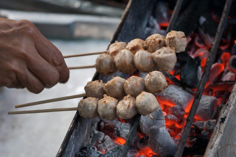 Grilling fishballs at Taling Chan
