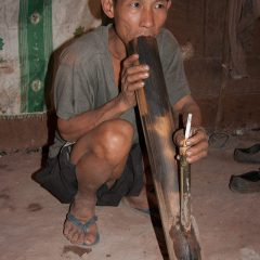 Akha chief smoking a cigarette with a water pipe