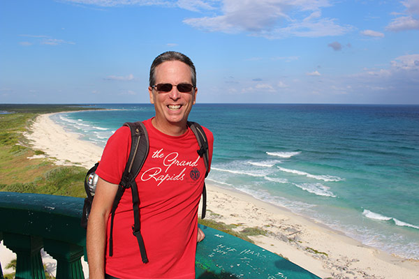 Tony enjoys the view over the East Coast of Cozumel from the lighthouse at Punta Sur