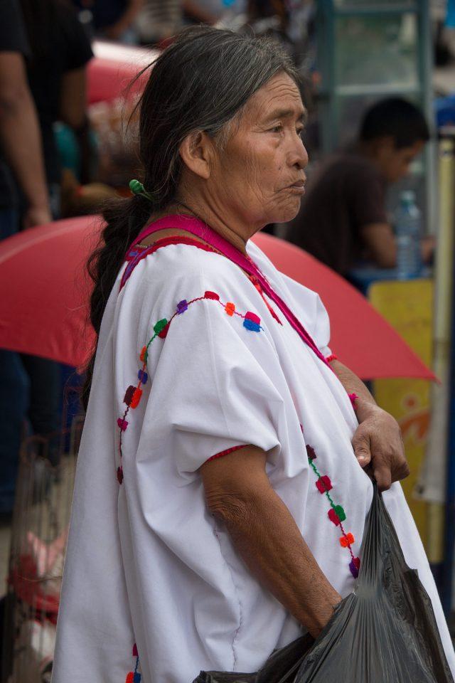 Woman wearing white huipil in San Cristobal