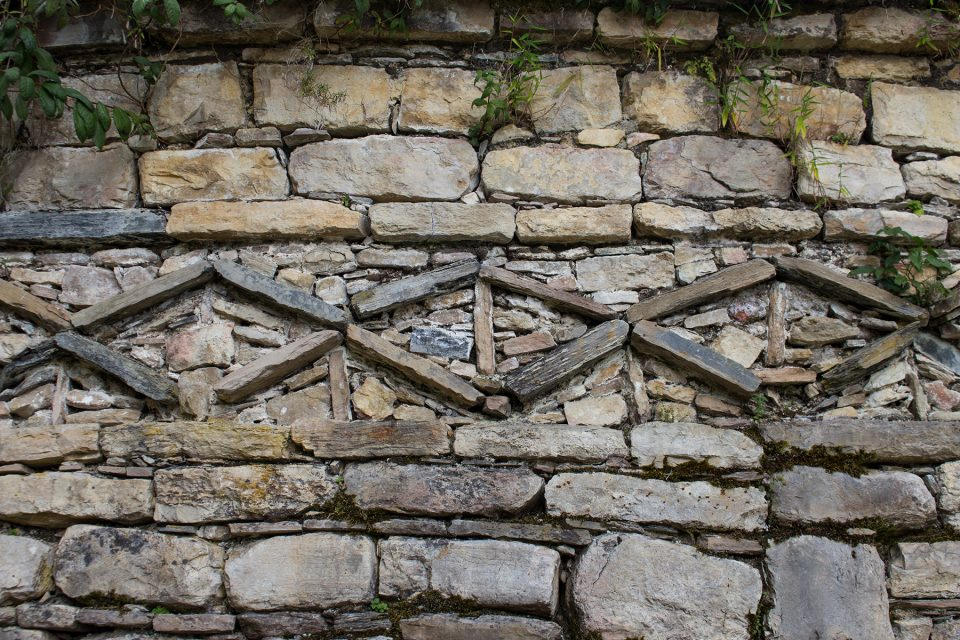 Kuelap frieze on a stone hut