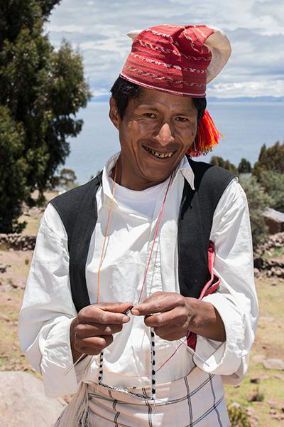 Man knitting on Isla Taquile