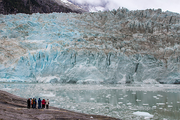 Dwarfed by the massive Pia Glacier