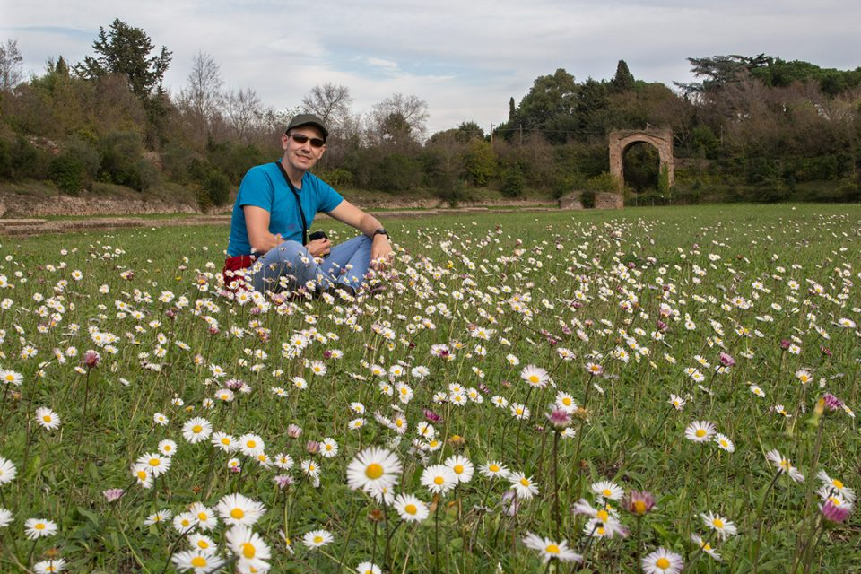 Rome off the beaten path: Thomas sits among flowers on an old Roman race track