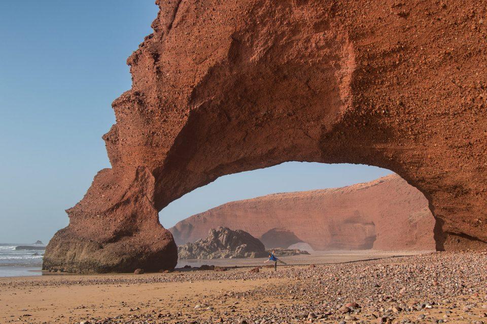 Thomas under giant central arch on Legzira Beach