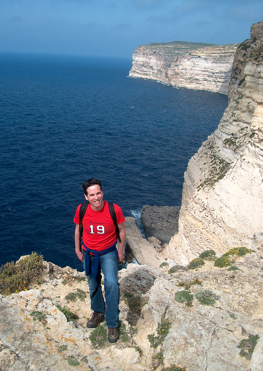 Tony hikes along the steep cliffs of Gozo