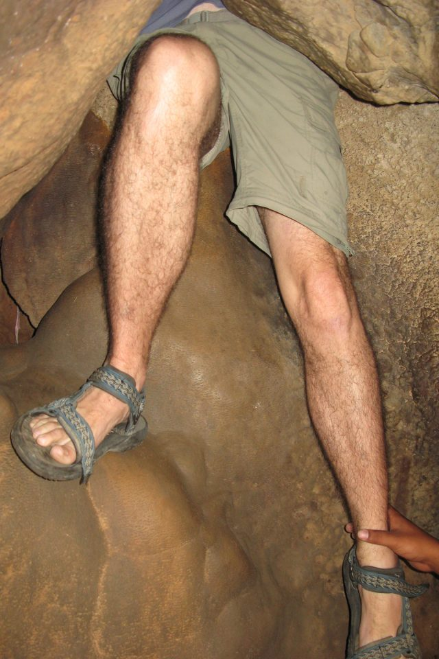 Tony crawls into a lower chamber