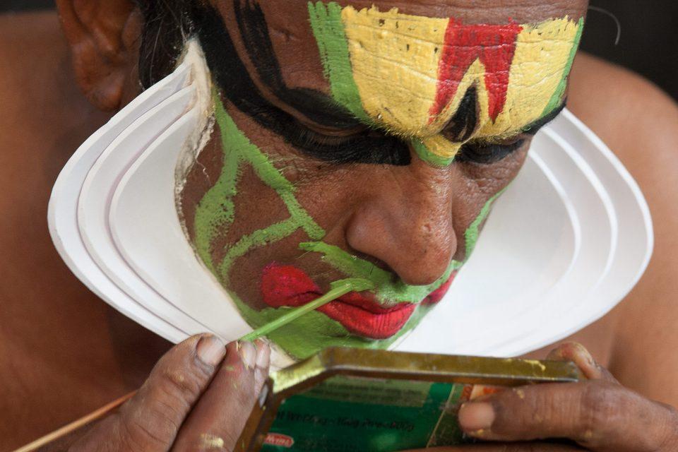 Applying Kathakali makeup