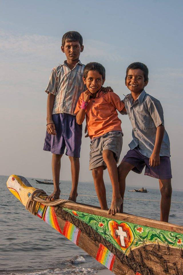 Kids on a fishing boat along the coast of Maharashtra
