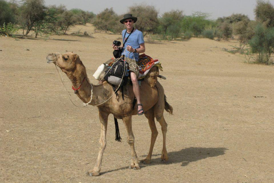 Tony learning to ride a camel